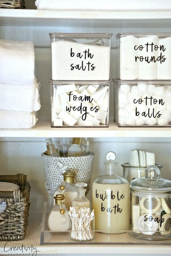 Bathroom Organization Ideas: Glass Boxes and Glass Bottles