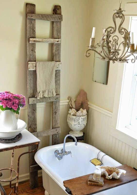 Farmhouse Bathroom Ideas: Antique Wood Ladder and Chandelier